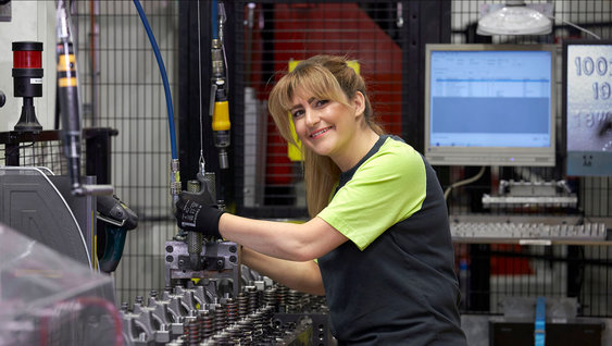 A woman in a factory environment