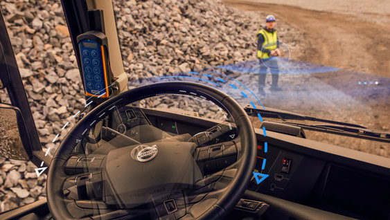 A driver steering the Volvo FH via remote from the outside