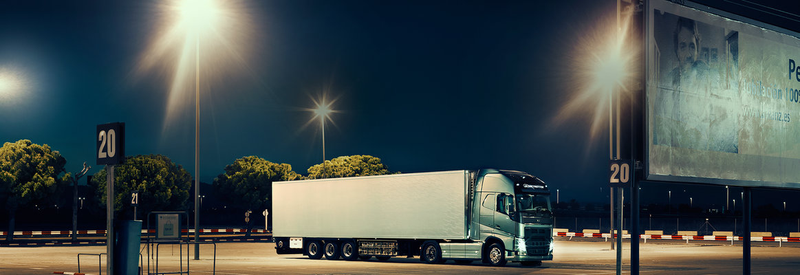Volvo FH tractor with trailer parked in the dark