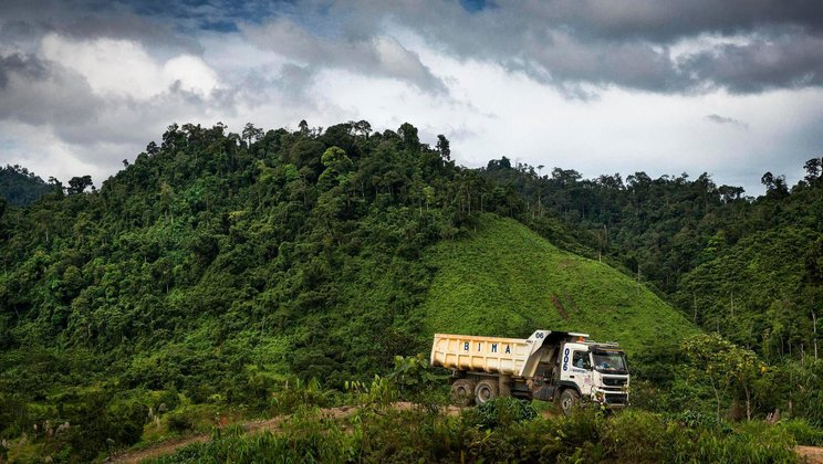 Volvo FMX driving through Borneo jungle.
